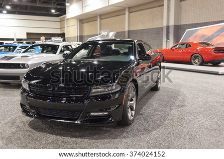 CHARLOTTE, NC, USA - November 11, 2015: Dodge Charger R/T on display during the 2015 Charlotte International Auto Show at the Charlotte Convention Center in downtown Charlotte. - stock photo