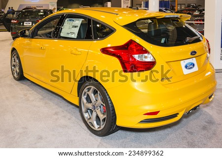 CHARLOTTE, NORTH CAROLINA - NOVEMBER 20, 2014: Ford 2015 Focus ST on display during the 2014 Charlotte International Auto Show at the Charlotte Convention Center. - stock photo