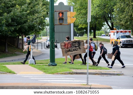 CHARLOTTESVILLE, VA–July 8, 2017: Counter-protesters head home after members of a North Carolina group rallied in a local park.