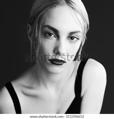 Charm fashion photo of young blonde beauty with creative make-up. - stock photo