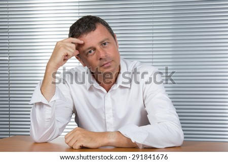 Charming and handsome Business man at his office - stock photo