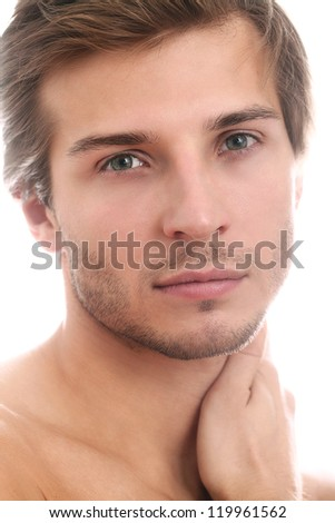 Charming and handsome man face close up over a white background - stock photo