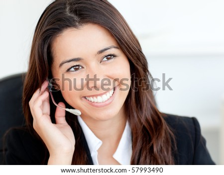Charming asian businesswoman wearing headphones against white background - stock photo