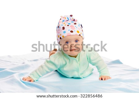 Charming baby girl in a hat. Studio - stock photo