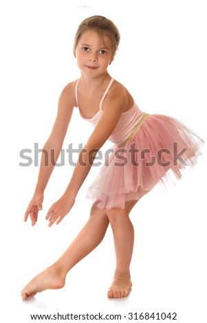 Charming ballerina child of school age in a short pink dance dress -Isolated on white background - stock photo
