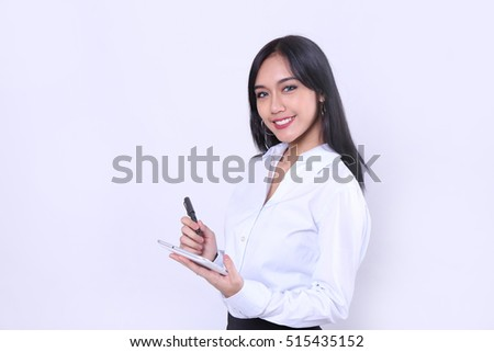Charming beautiful tan skin Asian woman hand use tablet and pen. Presenting your product. Successful business woman looking confident and smiling.