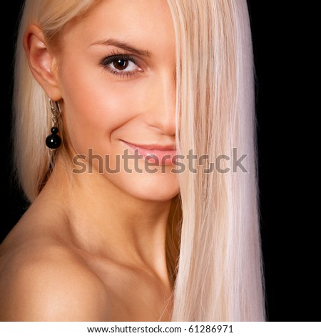 Charming blonde, it is isolated on black background.