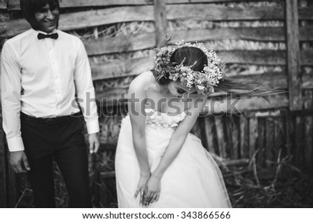 charming bride and groom in hayloft at summer day - stock photo
