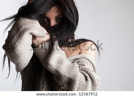 Charming brunette hiding her face by hair. Fashion Photo. - stock photo