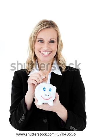 Charming businesswoman saving money in a piggy-bank against a white background - stock photo