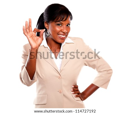 Charming businesswoman saying great job and looking at you on isolated background - stock photo