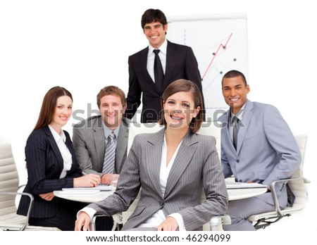 Charming businesswoman sitting in front of her team in a meeting