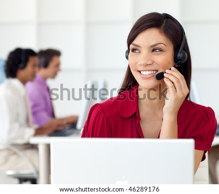 Charming Businesswoman talking on headset at work