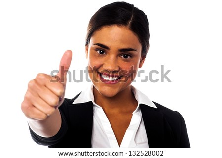 Charming corporate woman gesturing thumbs up. Keep up the great work. - stock photo