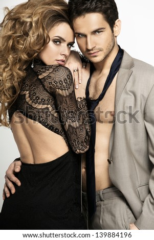 Charming couple posing - stock photo