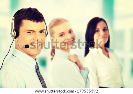 Charming customer service representative with headset on - stock photo