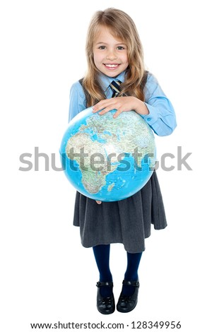 Charming cute school child holding globe with both hands, aerial view. - stock photo