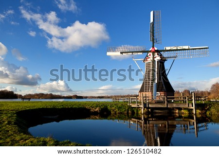 charming Dutch windmill over blue sky