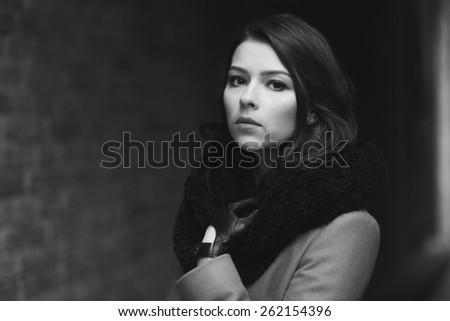 Charming fashion female modell near the window - stock photo