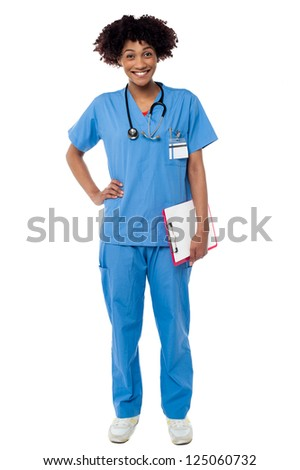 Charming female doctor with clipboard in hand, full length studio shot. - stock photo