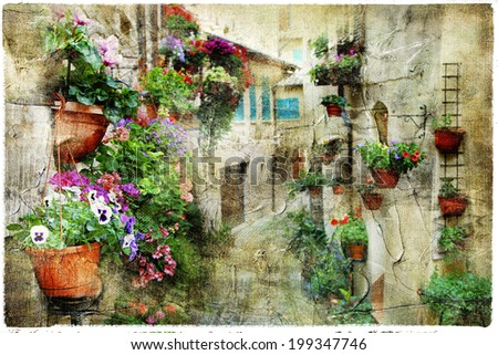 charming floral streets in Spello, Umbria Italy, artistic pictur - stock photo