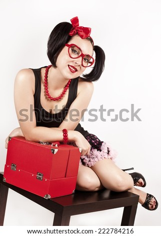 Charming girl in glasses with red case - stock photo