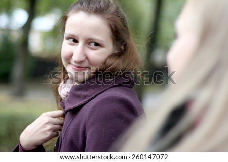Charming girl portrait outdoors - stock photo