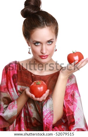 Charming girl with a tomato in hands. White background