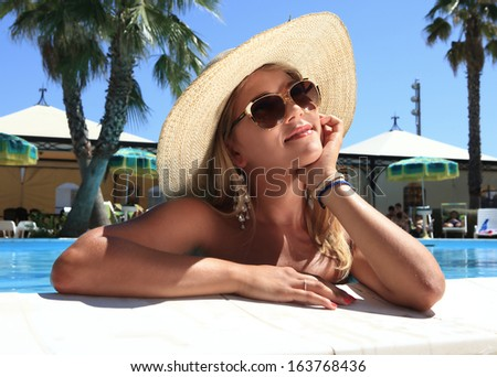 charming girl with straw hat