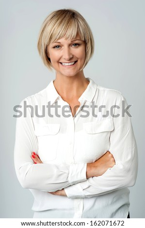 Charming lady in casuals posing smilingly - stock photo