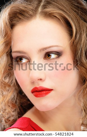 Charming lady in red evening dress, on black background. - stock photo