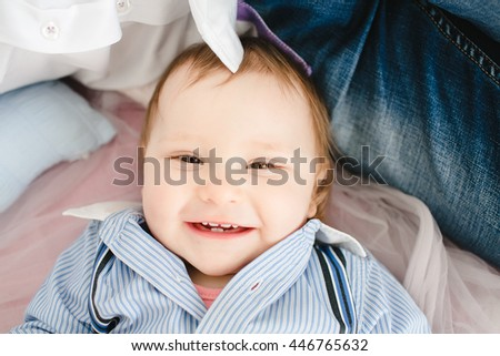 charming little  boy laughing at the camera