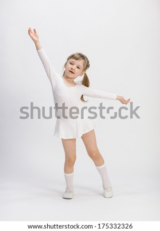 Charming little girl dancing, white background - stock photo