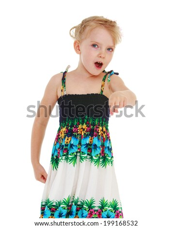 Charming little girl showing forefinger aside - stock photo