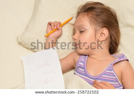 Charming little girl sleeping with picture in her bed at home - stock photo