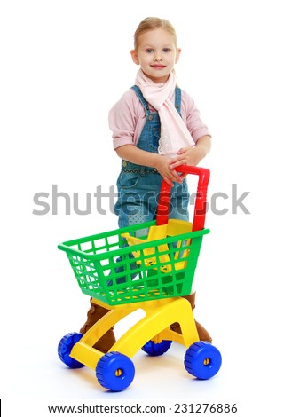Charming little girl with a toy truck.Childhood education development in the Montessori school concept. Isolated on white background. - stock photo