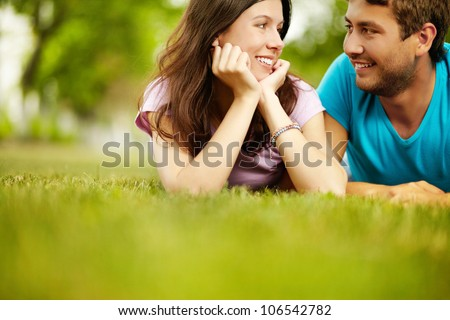Charming lovers spending time in he open air enjoying the company of each other - stock photo