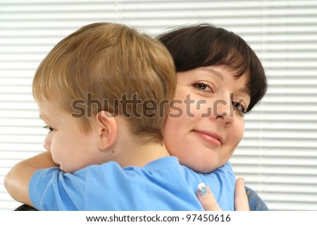 Charming mother with son on a light background - stock photo