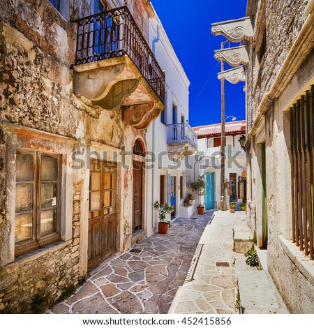 charming narrow streets of traditional greek villages - Naxos is - stock photo