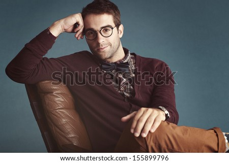 Charming old-fashioned male relaxing in couch