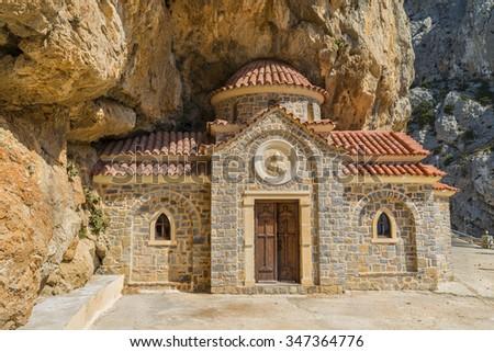 Charming old orthodox church of Saint Nicholas the Wonderworker, built in the rock.Crete island. Greece.Europe. - stock photo