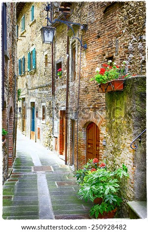 charming old streets of medieval towns of Italy - stock photo