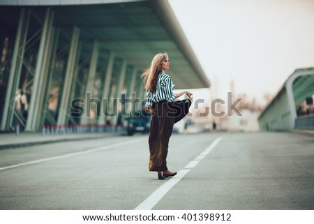 charming  positive  girl going  on a wide street
