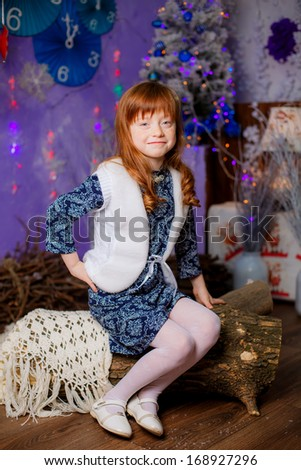 charming red-haired girl, 6 years old, smiling, christmas, studio portrait - stock photo
