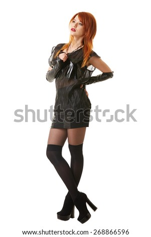 Charming red-haired model posing in gothic clothes - stock photo