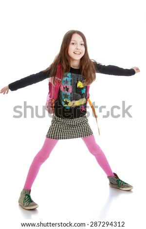 Charming schoolgirl widely spreading his arms out to the sides-Isolated on white background - stock photo