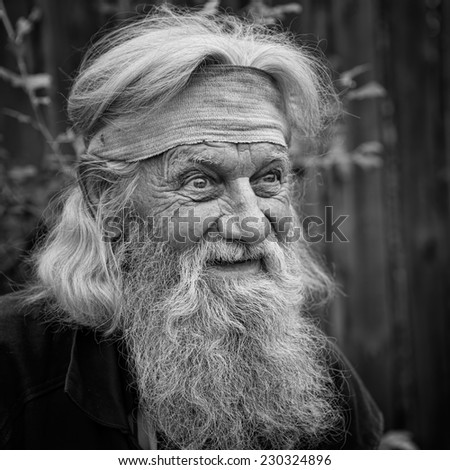 Charming senior old man with expressive eyes in black and white - stock photo