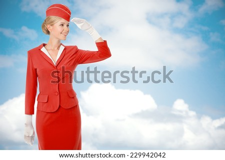 Charming Stewardess Dressed In Red Uniform. Sky With Clouds Background. - stock photo