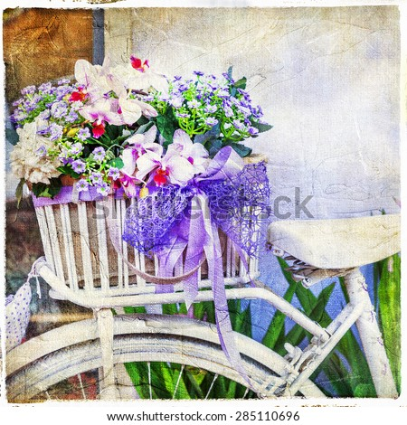 charming street decoration -vintage bike with flowers - stock photo