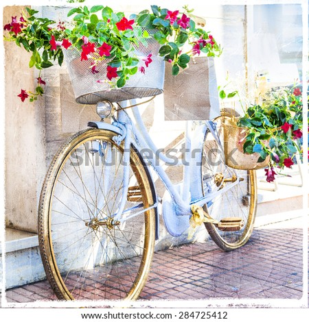charming street decoration with bike and flowers, artistic picture - stock photo